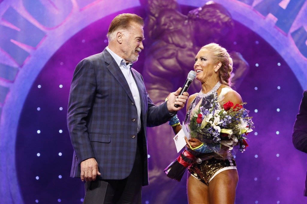 2019 Fitness International winner Ryall Graber is congratulated by Arnold Schwarzenegger photo by Dave Emery.JPG